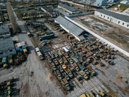 Old rusty broken Russian military cars for scrap metal, aerial view.