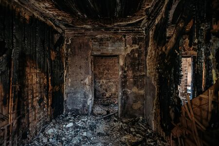 Burnt old rural house interior. Consequences of fire. Stok Fotoğraf