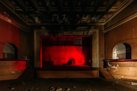 Old burnt creepy abandoned ruined haunted theater.