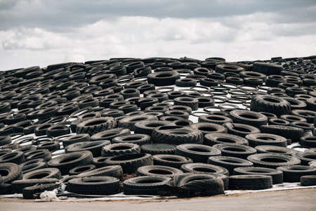 Livestock manure weighted with tires for fermentation covered with vinyl sheet.