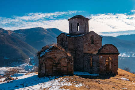 Old abandoned church in North Caucasian mountains. Archivio Fotografico