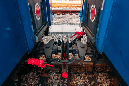 Coupling between two train carriages in narrow-gauge railway.