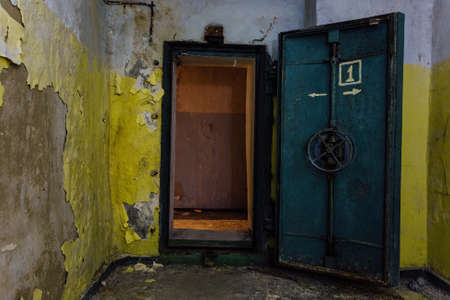 Opened heavy steel armored hermetic door in the Soviet bomb shelter.