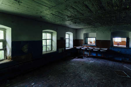Abandoned school interior, dirty room, rotten peeled walls.