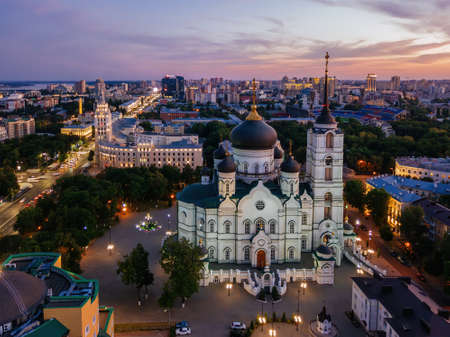 Evening summer Voronezh cityscape. Annunciation Cathedral and Tower of Management of South-east railway at sunset.