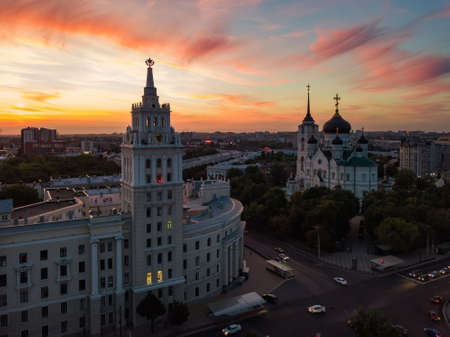 Evening summer Voronezh cityscape. Annunciation Cathedral and Tower of Management of South-east railway at sunset. Standard-Bild