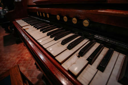 Old vintage harmonium piano keyboard. Close up view.