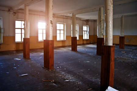 Abandoned building interior, dirty room, rotten peeled walls