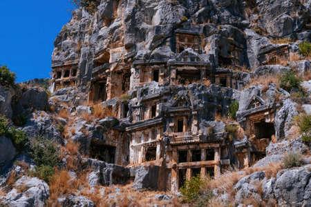Ancient lycian rock tomb ruins in Demre, former Myra, Antalya, Turkey.