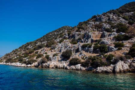Ancient ruins of the city on the Kekova island, Turkey. 免版税图像