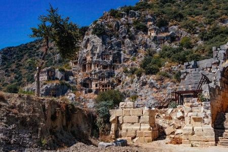 Ancient lycian rock tomb ruins in Demre, former Myra, Antalya, Turkey. Stock Photo