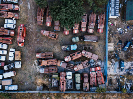 Old rusty broken Russian fire trucks for scrap metal, aerial view.