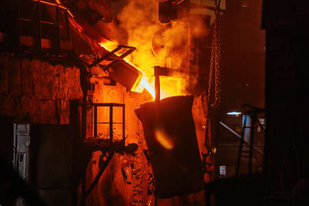 Metal casting process in metallurgical plant.Liquid metal pouring into ladle for casting.