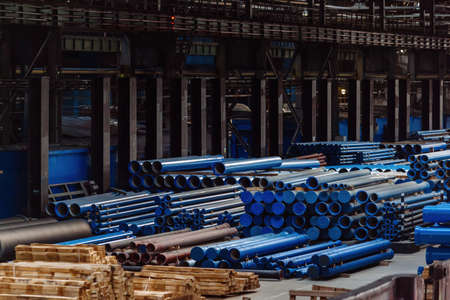 New cast iron pipes for pipeline construction in warehouse. Zdjęcie Seryjne