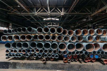 New cast iron pipes for pipeline construction in warehouse. 版權商用圖片