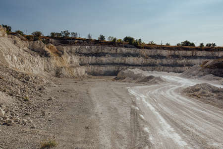 Inside open chalky quarry pit in autumn.