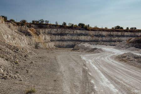 Inside open chalky quarry pit in autumn. Zdjęcie Seryjne
