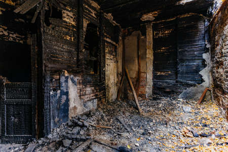 Burnt old house interior. Consequences of fire.