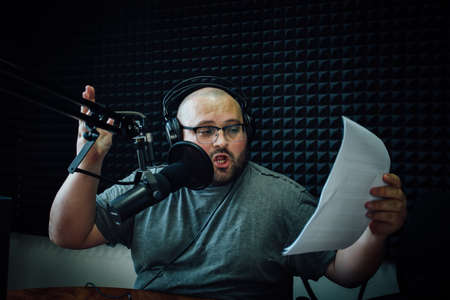 Talking male radio presenter in radio station.
