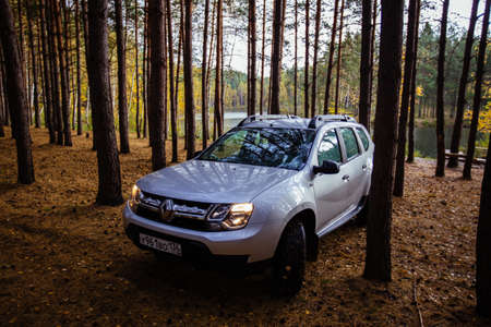 Renault Duster car in pine forest at Tula Region, Russia - October 07, 2020.