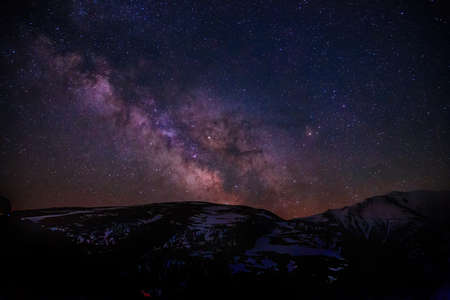Milky Way Galaxy with stars and mountain landscape. 版權商用圖片