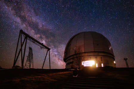 Special astrophysical observatory against starry night sky with milky way.