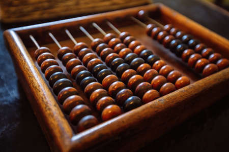 Old vintage wooden abacus, close up view.