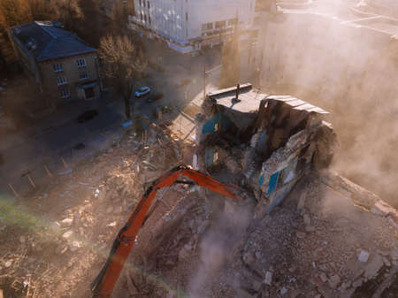 Aerial view of demolition site. Process of demolition of old industrial building.