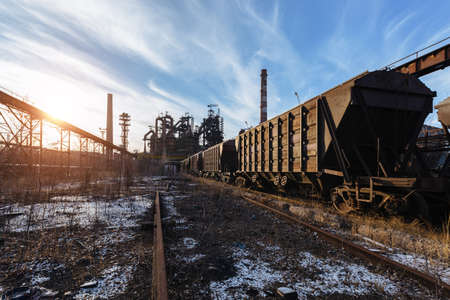 Old rusty freight train at metallurgical factory.