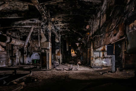 Burnt interior of industrial building or warehouse. Consequences of fire.