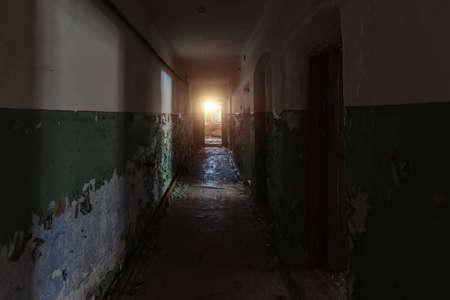Dark dirty corridor of old abandoned building. Imagens