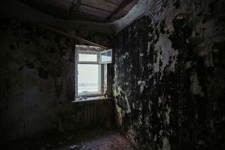 Interior of messy dirty room at old abandoned building