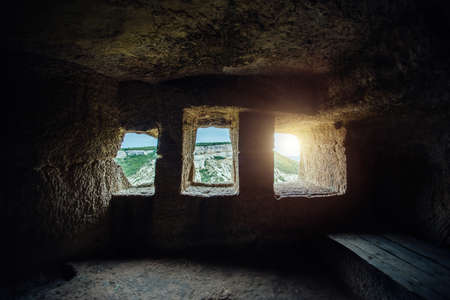 Room inside ancient cave city Chufut Kale, Bakhchisaray, Crimea. Stok Fotoğraf