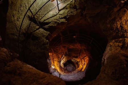 Old ancient spiral staircase in the well Tik Kuyu, in Chufut Kale, Bakhchisaray, Crimea Bakhchisarai Crimea