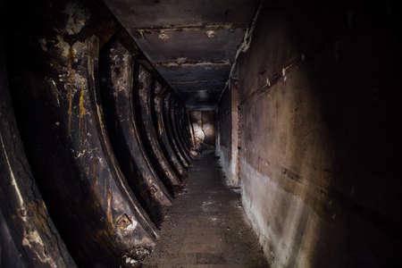 Dark burnt abandoned Soviet bunker after fire.