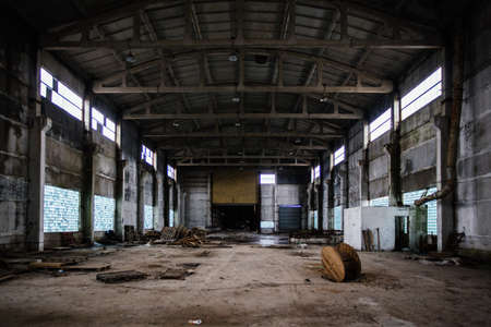 Old abandoned large industrial hall. Empty warehouse.