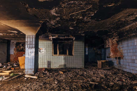 Burnt interior of industrial building. Consequences of fire. Reklamní fotografie