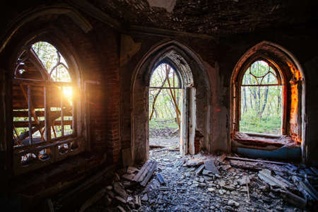Inside old ruined abandoned historical Khvostov's mansion in Gothic style. 免版税图像