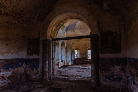 Large hall at old ancient abandoned ruined historical building.