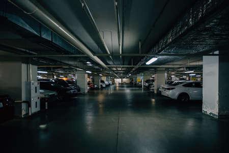 Inside underground car parking. Modern parking lots.
