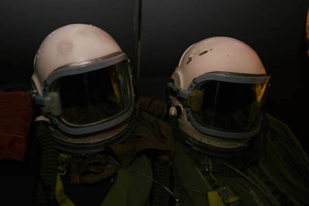 Old green astronaut suits with white helmets. Archivio Fotografico