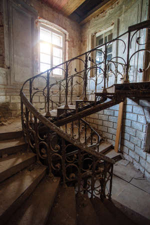 Old vintage spiral staircase at the old abandoned building Archivio Fotografico