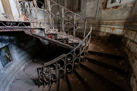 Old vintage spiral staircase at the old abandoned building.