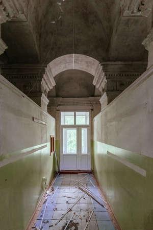 Arched corridor in old abandoned historical building. Archivio Fotografico