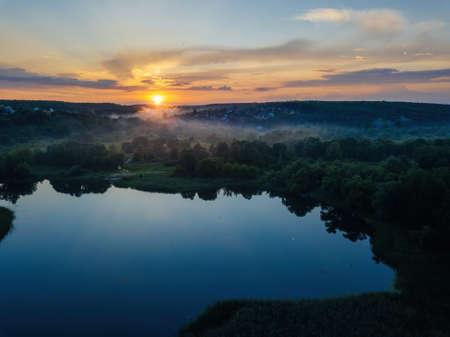 Sunset above the river in natural rural landscape.