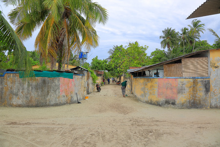 Maldives, Dhangethi Island. One of the streets on island. Poor society, old houses and sand roads. Banco de Imagens