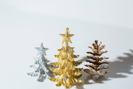 Closeup view of christmas decoration isolated on white background. Silver and gold christmas tree. Beautiful christmas backgrounds. Stock Photo