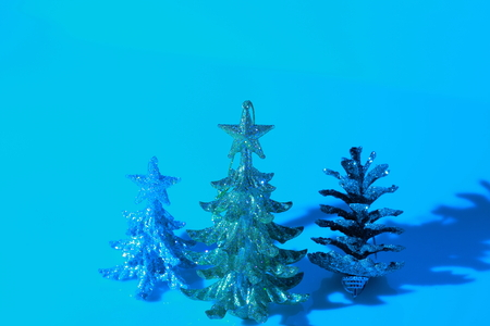 Closeup view of christmas decoration isolated in blue. Silver and gold christmas tree. Beautiful christmas backgrounds.