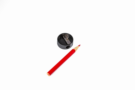 Closeup view of pencil and sharpener isolated. Office, Stationery, Supplies, School background. Imagens