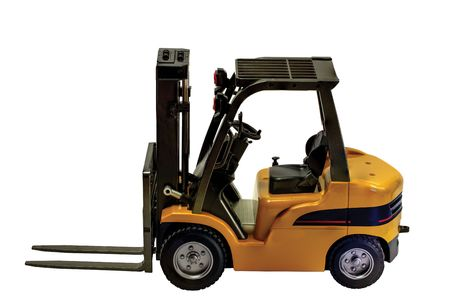 Close up view of a forklift toy radiocontroled car isolated. Hobby backgrounds.